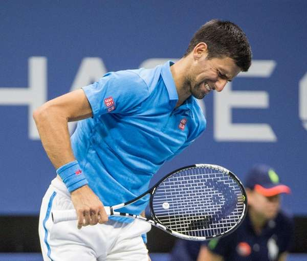 Novak Djokovic feels some pain during his match