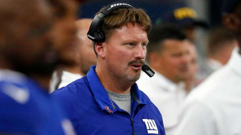 New York Giants head coach Ben McAdoo watches