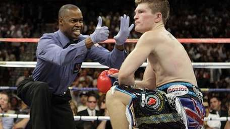 British boxer Ricky Hatton, right, fights the countdown