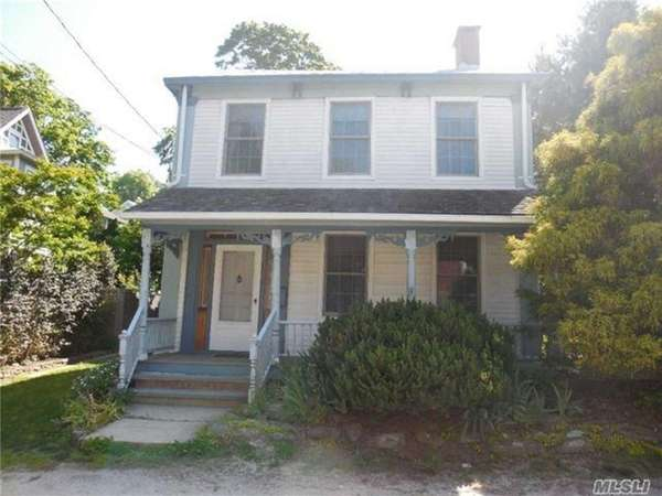 This three-bedroom, two-bathroom Port Jefferson home, listed for