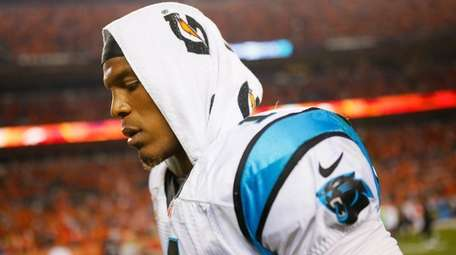 Cam Newton #1 of the Carolina Panthers walks
