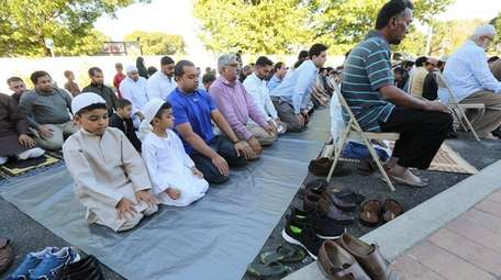 Muslims observe Eid al-Adha in an overflow section