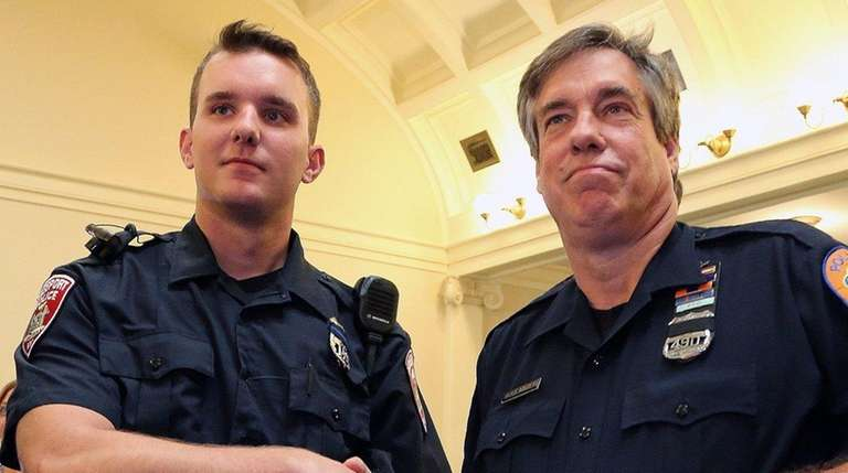Freeport Police Officer Corey Cooke, left, and Nassau
