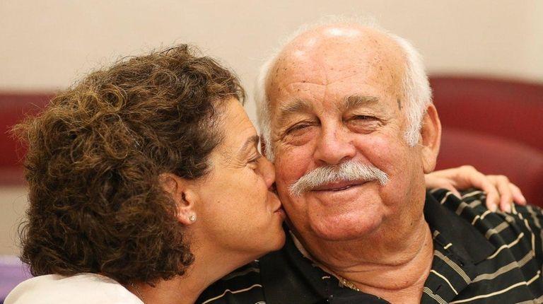 Anthi Mavlios of Glen Head, left, kisses her