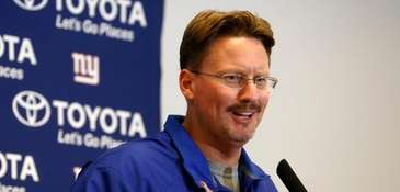 Ben McAdoo responds to questions in a
