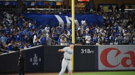 Los Angeles Dodgers fans display a banner during