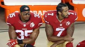 Colin Kaepernick, No. 7, and Eric Reid, No.