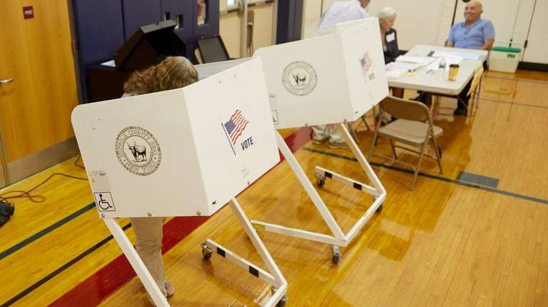 A woman casts her primary vote at a