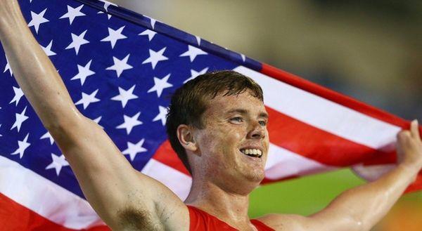 East Northport's Michael Brannigan celebrates winning gold in