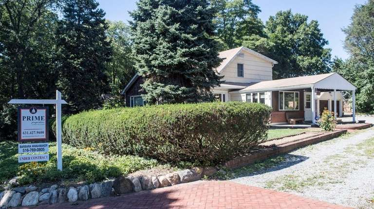 This Huntington Station home has an under-contract sign