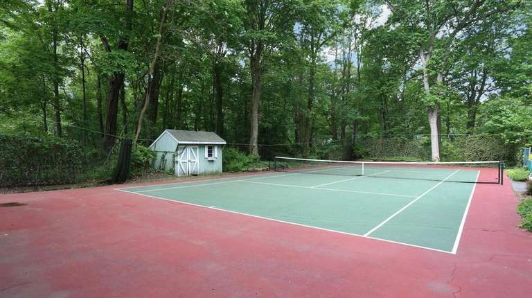 In the back half of this one-acre Setauket