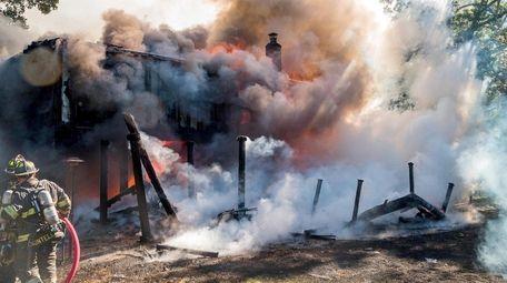Firefighters battle blaze in house on Merrick Road