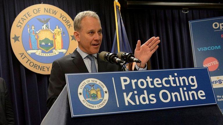 New York Attorney General Eric T. Schneiderman holds