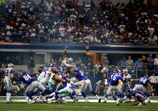 Giants kicker Randy Bullock (5) boots an extra