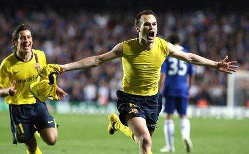 Andres Iniesta, right, celebrates after scoring in extra