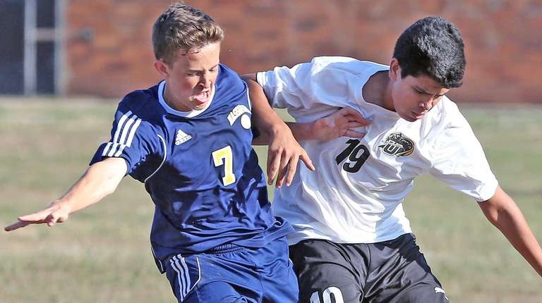 Massapequa's Ryan McMahon, who scored a goal, works