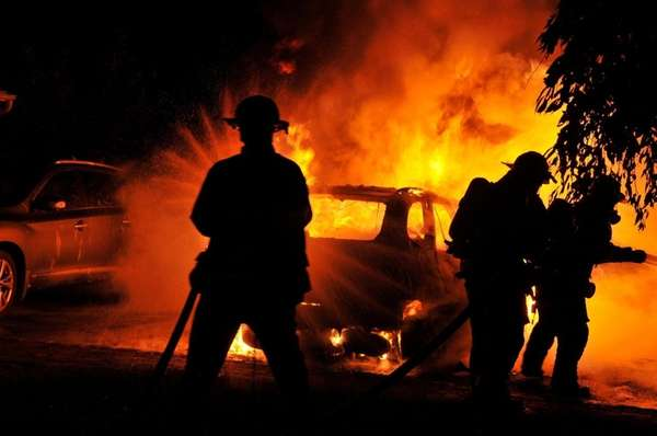 Firefighters battle a blaze that engulfed vehicles in