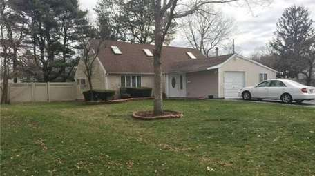 This four-bedroom Islandia farm ranch is listed for