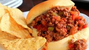 Ground beef is cooked with diced vegetables, ketchup,