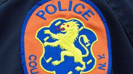 A police officer wears the patch of the