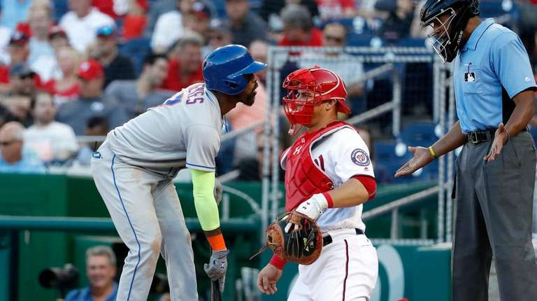 Jose Reyes argues a called strike with plate