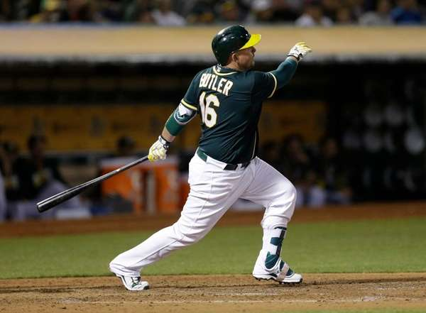 Oakland Athletics' Billy Butler watches his RBI sacrifice