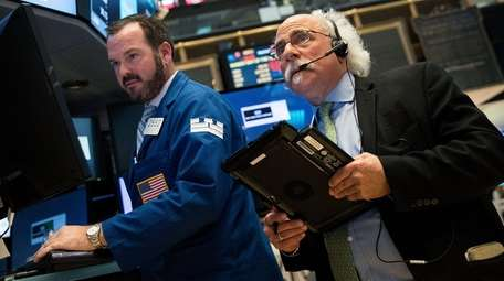 Traders and financial professionals work on the floor