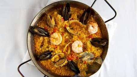 Seafood paella includes mussels, clams, shrimp, lobster and