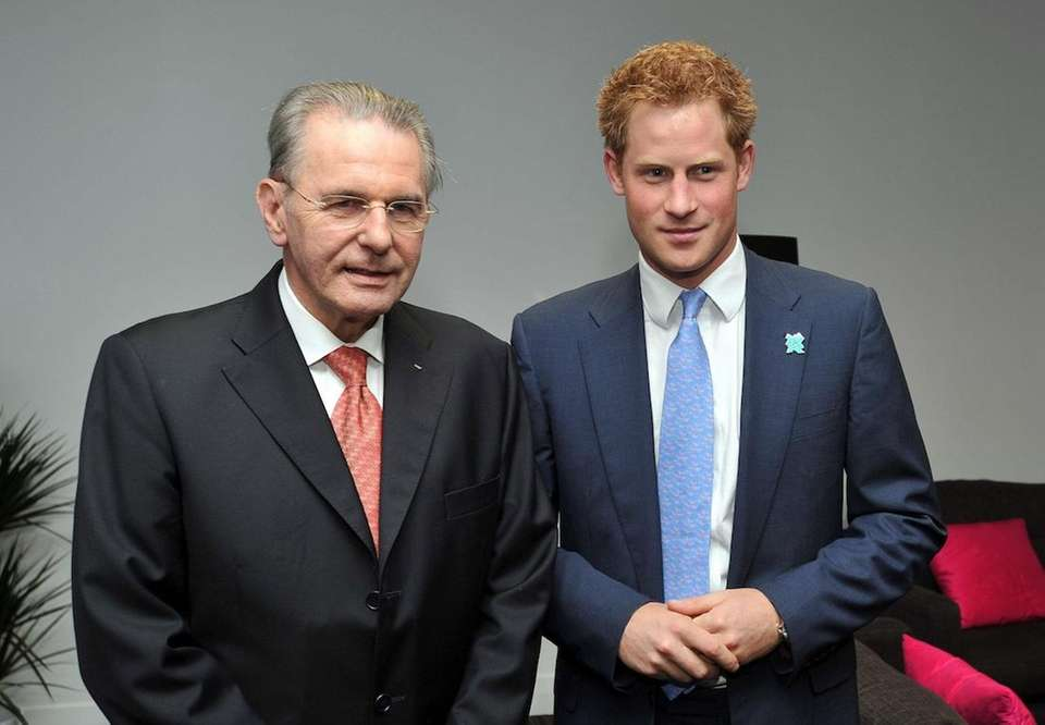 Prince Harry poses for pictures with President of