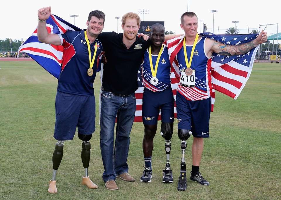 Prince Harry poses with U.K. Armed Forces athlete