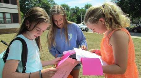 Incoming sixth-graders Meghan Tucker, Nicole Baudo and Nora