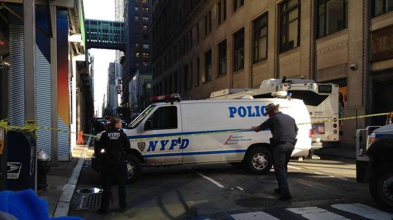 A police van blocks 32nd Street near Seventh