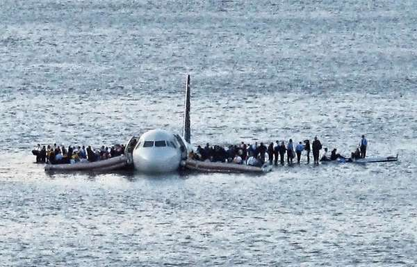 Passengers wait on the wings of a US