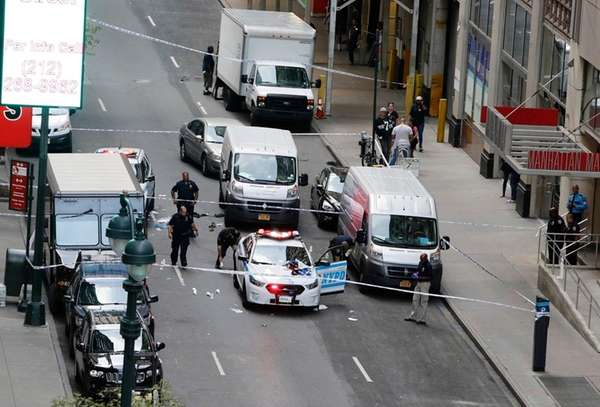 NYPD officers investigate the scene in midtown Manhattan