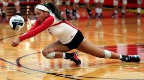 Smithtown East's Haley Anderson (5) with the dig