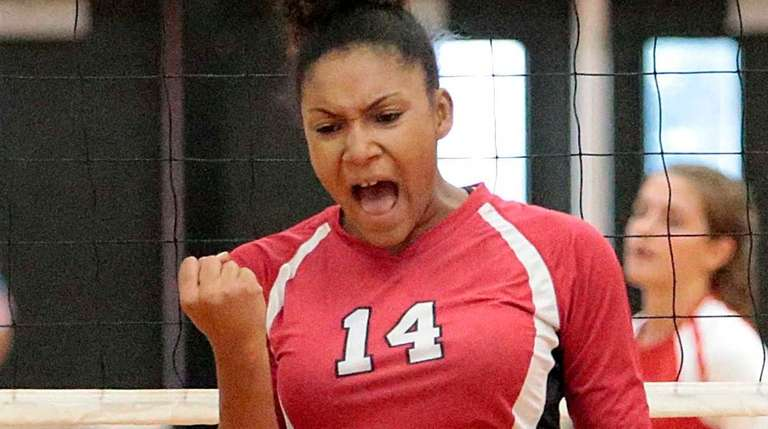 Newfield's Dayna Hunter (14) reacts after the spike