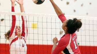 Newfield's Dayna Hunter (14) with the spike against