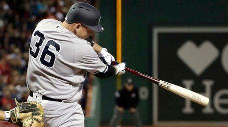 New York Yankees' Billy Butler hits an RBI