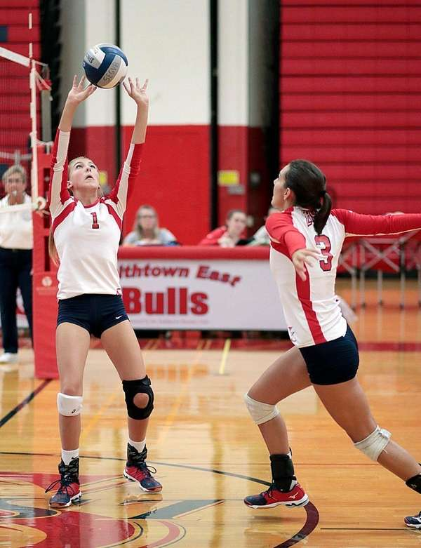 Smithtown East's Brooke Berroyer (1) sets the ball