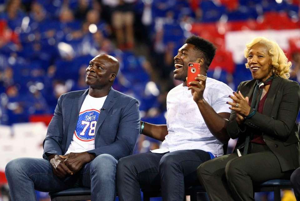 Hall of Famer Bruce Smith, left, a former