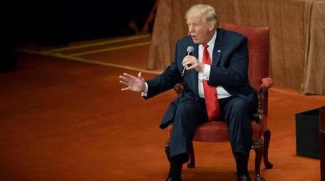 Republican presidential candidate Donald Trump answers questions during