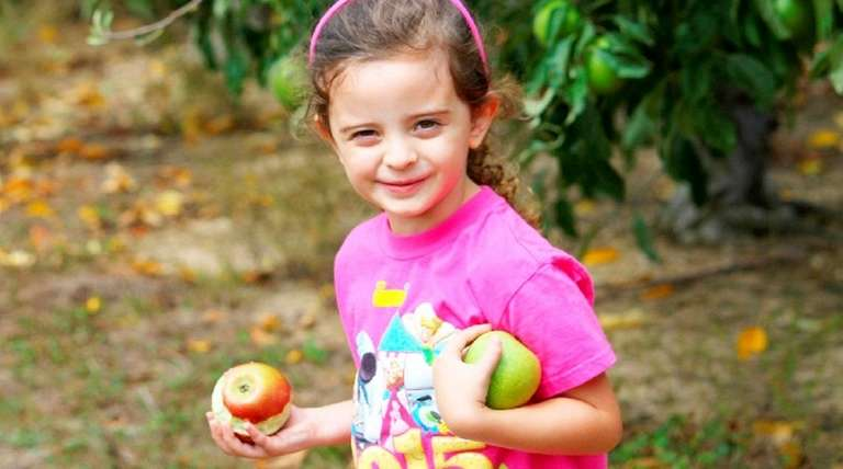 Emma Gagliano, 4, of Shirley, had fun apple