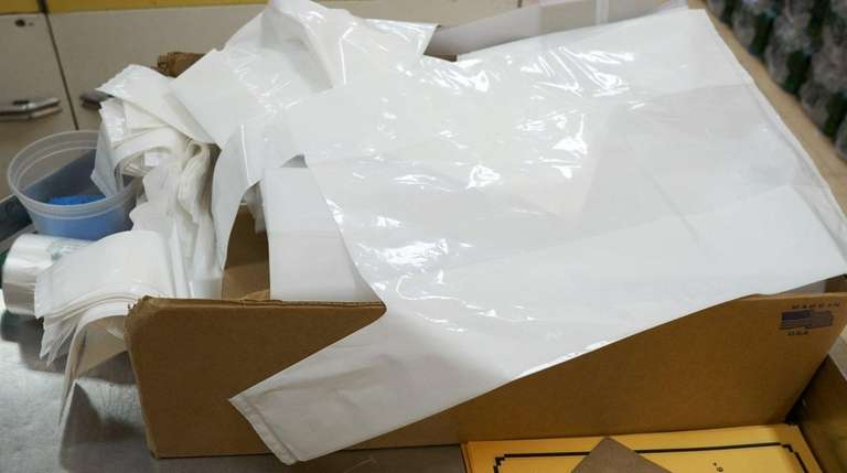 A box of thick plastic shopping bags sits