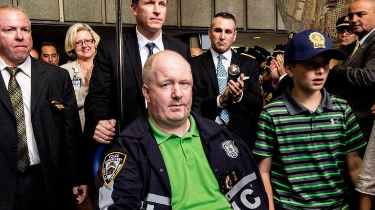 NYPD Officer Brian O'Donnell is pictured leaving Bellevue