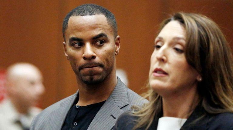 Darren Sharper looks toward his attorney, Blair Berk,