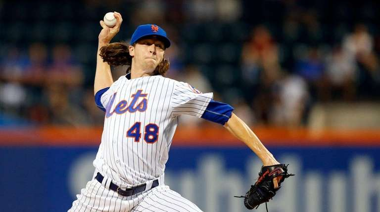 Jacob deGrom of the Mets pitches in the