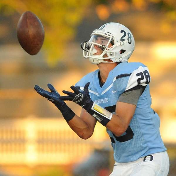 Oceanside's Dylan Judd catches the kickoff against Farmingdale