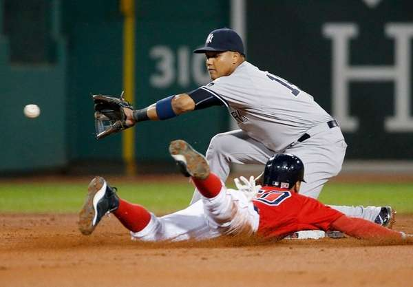 Boston's Mookie Betts steals second base as Starlin