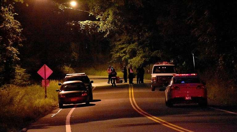 Police respond to a motorcycle crash in Mount