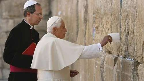 Pope Benedict XVI places a note in the